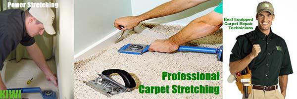 Technicians Stretching Carpet